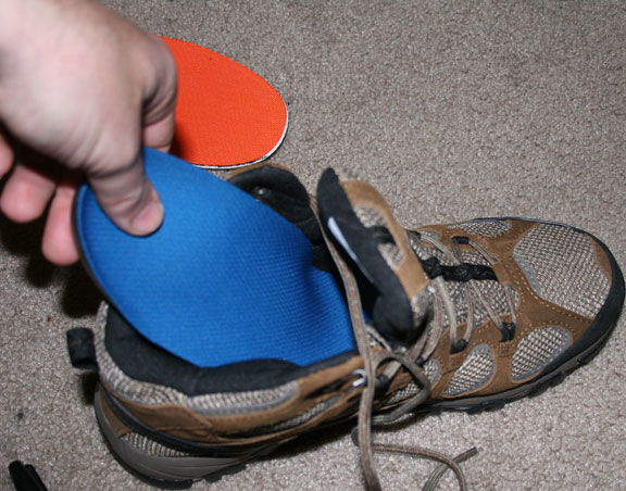 put insoles into the shoes